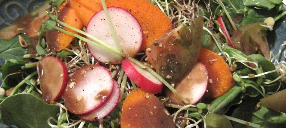 spinach salad with carrot radish tomato and sprouts