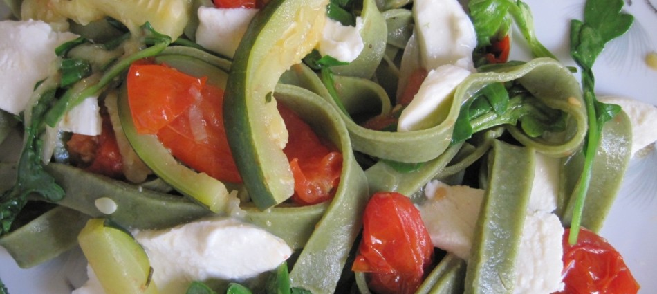 spinach fettuccine with fresh mozzarella, zucchini, roasted grape tomatoes and arugula