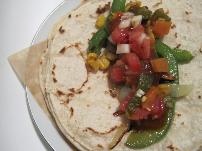 vegetarian taco with pepper onion corn and salsa