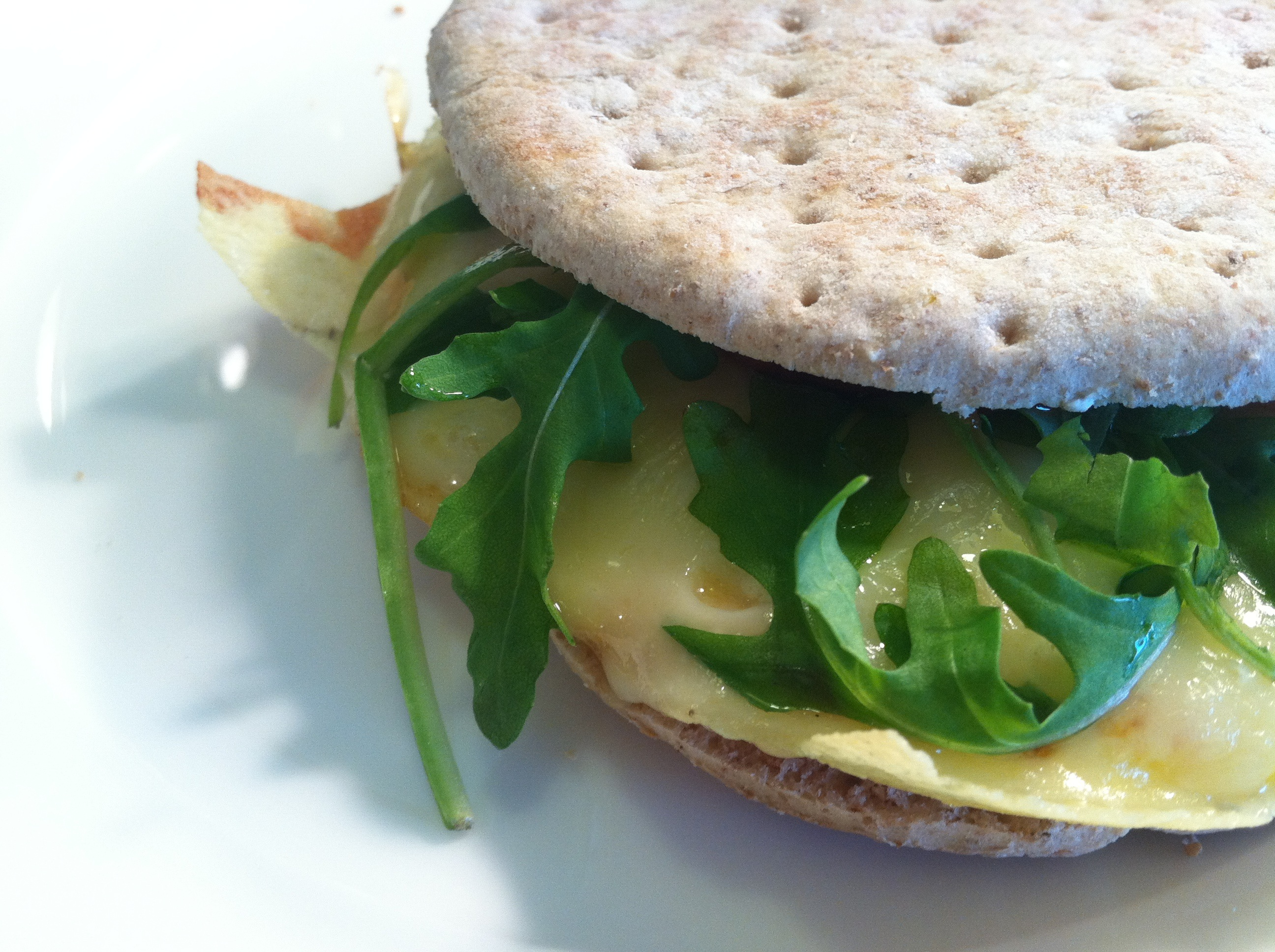 egg swiss and arugula breakfast sandwich
