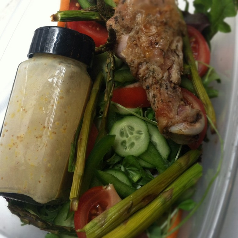 reuse an old spice jar to bring dressing for work lunch salad
