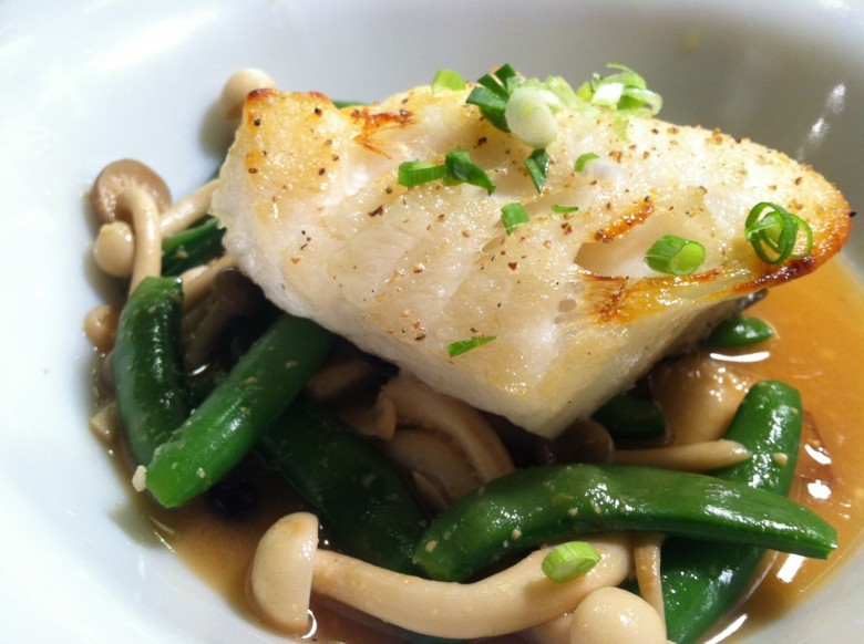 chilean sea bass with sugar snaps, beech mushrooms in a red miso ginger broth