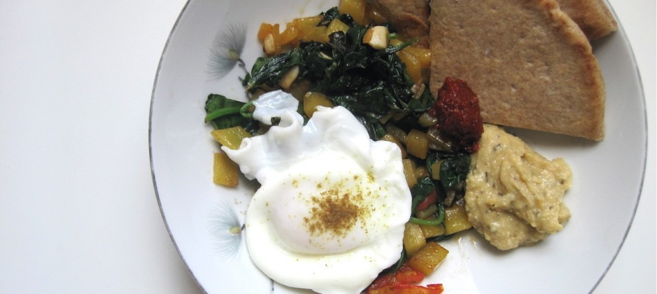 poached egg with sauteed dandelion greens golden beets hummus and pita