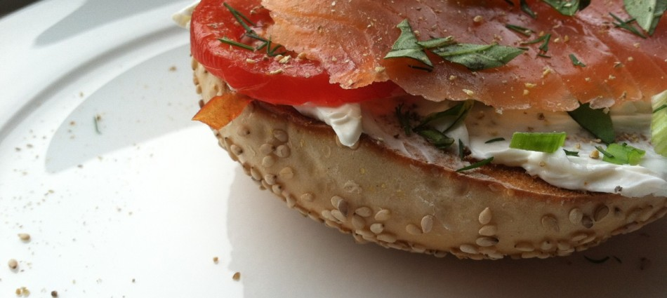 sesame bagel toasted with smoked salmon, tomato, cream cheese and fresh herbs